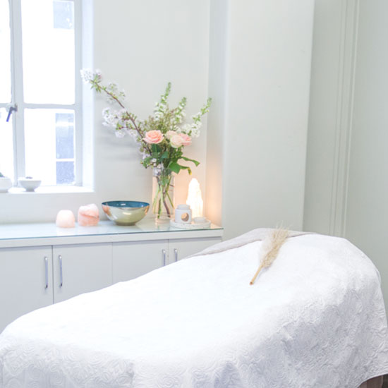 Beauty Refinery treatment room with flowers auckland city